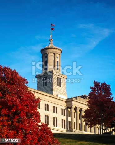 Tennessee State Capital Building in the fall with red filiage.