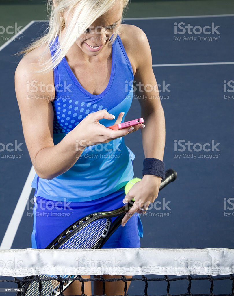 Tennis and cell phone royalty-free stock photo