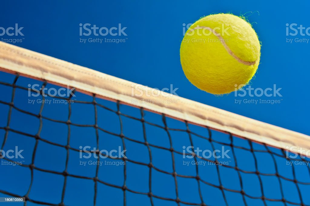 Tennis ball and net stock photo