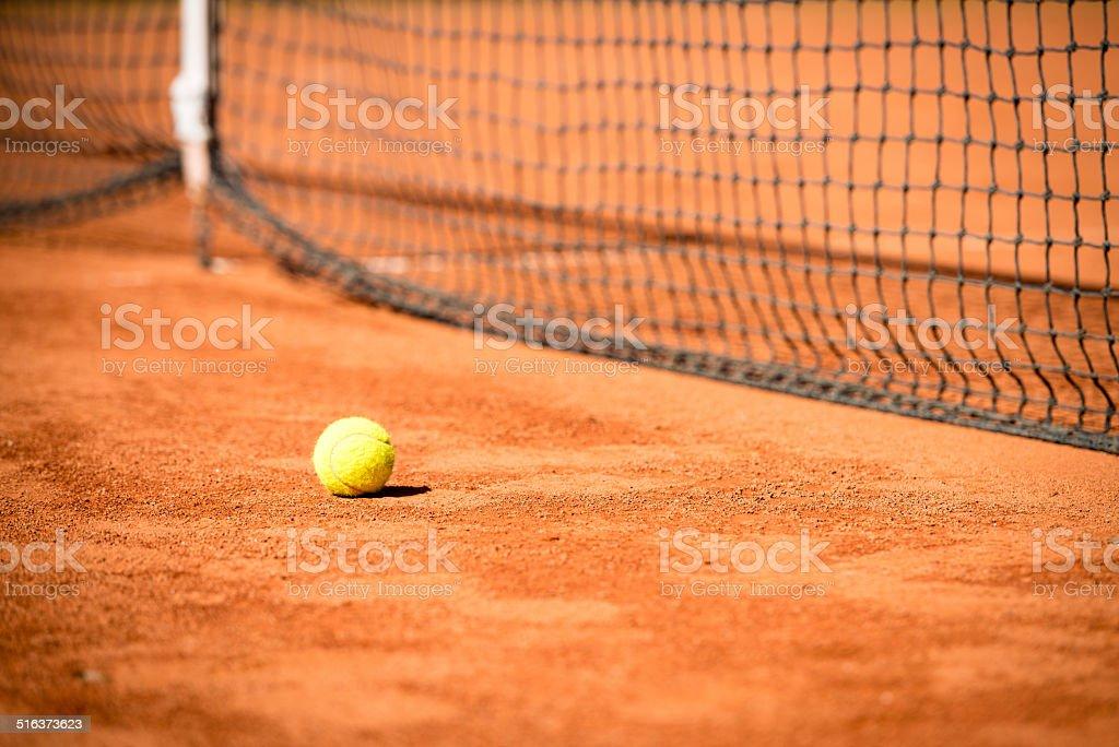 Tennis ball and net stock photo