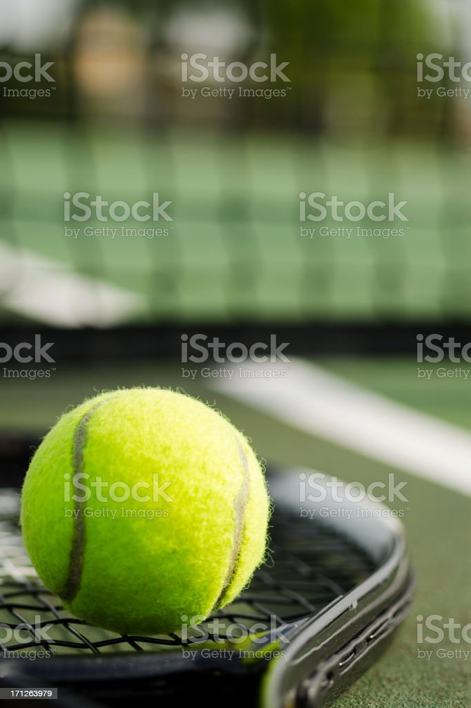 Tennis Ball and Racket on the Court Vertical royalty-free stock photo