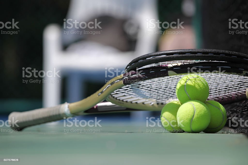 Tennis ball and racket stock photo