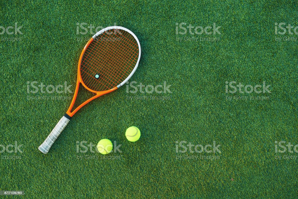 Tennis ball and rackets on grass royalty-free stock photo