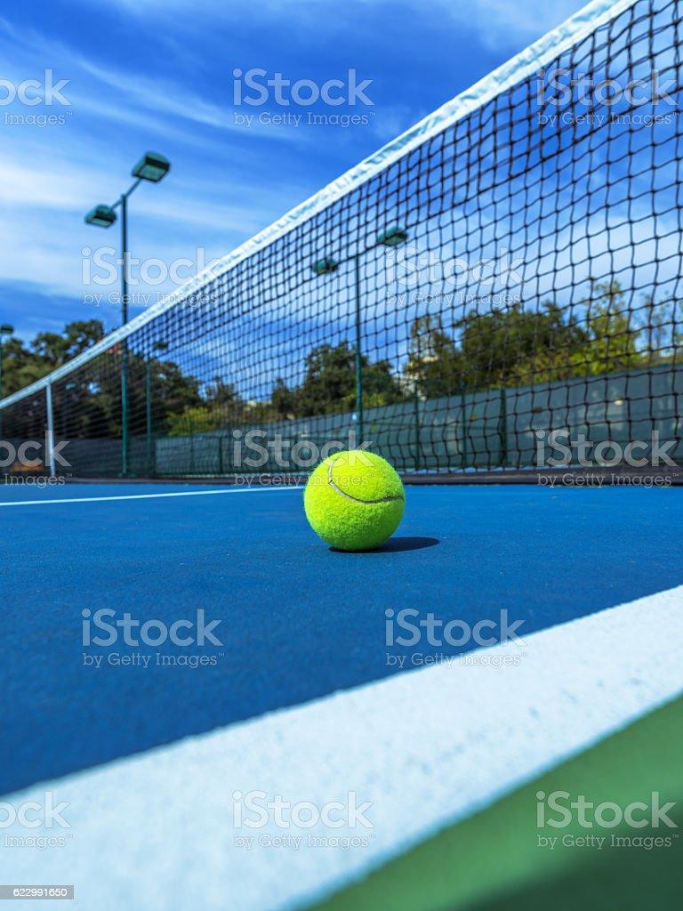 Tennis Ball - Blue Court - Black Net stock photo