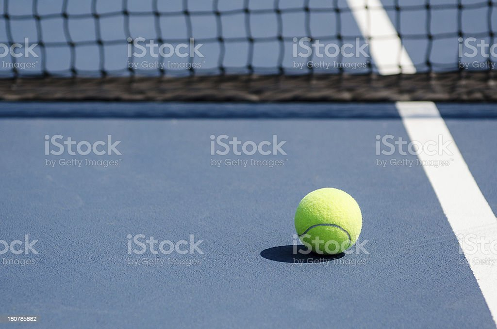 Tennis Ball by Net royalty-free stock photo