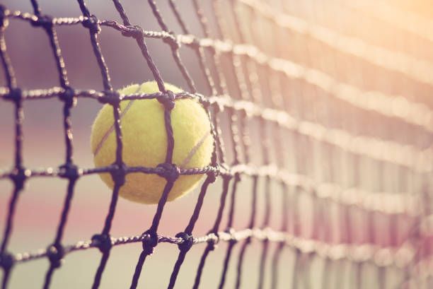 tennis ball hitting the tennis net at tennis court with copy space. - tennis stock pictures, royalty-free photos & images