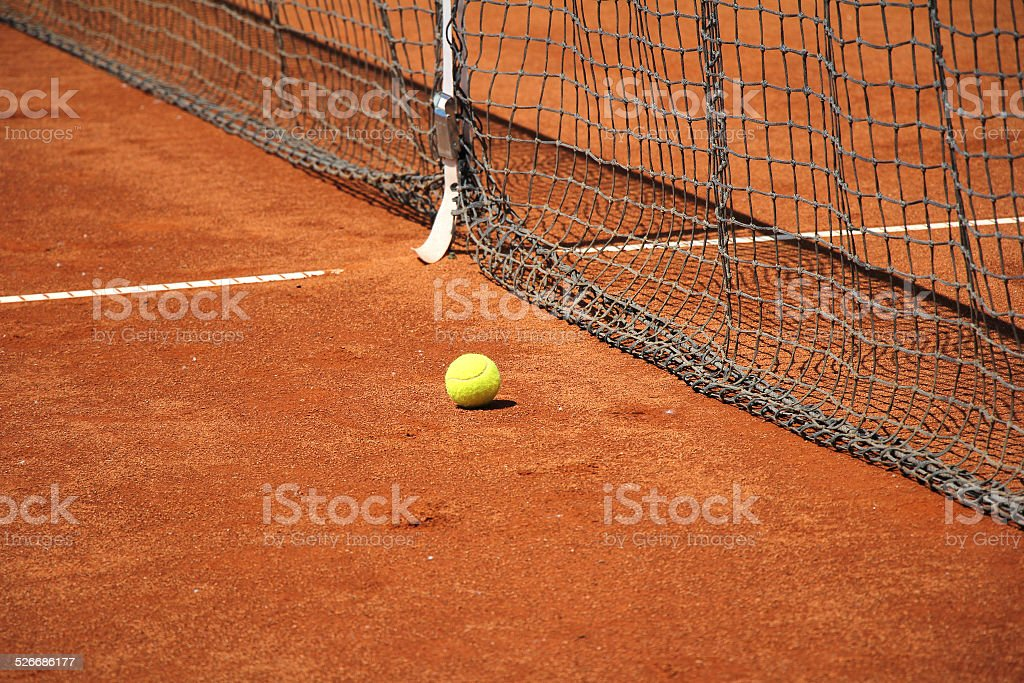 Tennis ball in front of the net stock photo