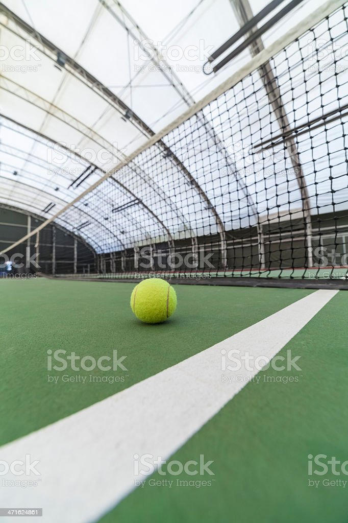 tennis ball in indoor court royalty-free stock photo