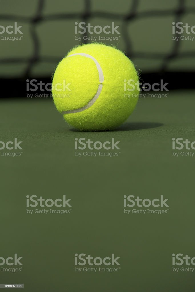 Tennis Ball Isolated on the Court royalty-free stock photo