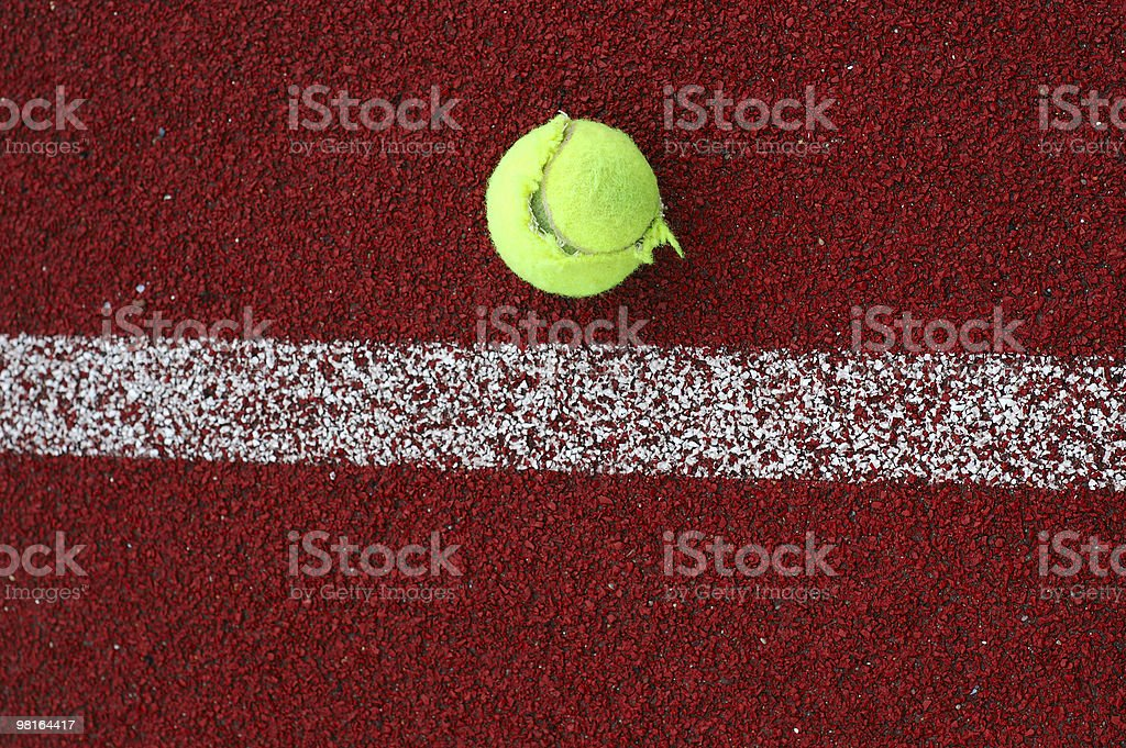 Tennis ball near the line on court royalty-free stock photo