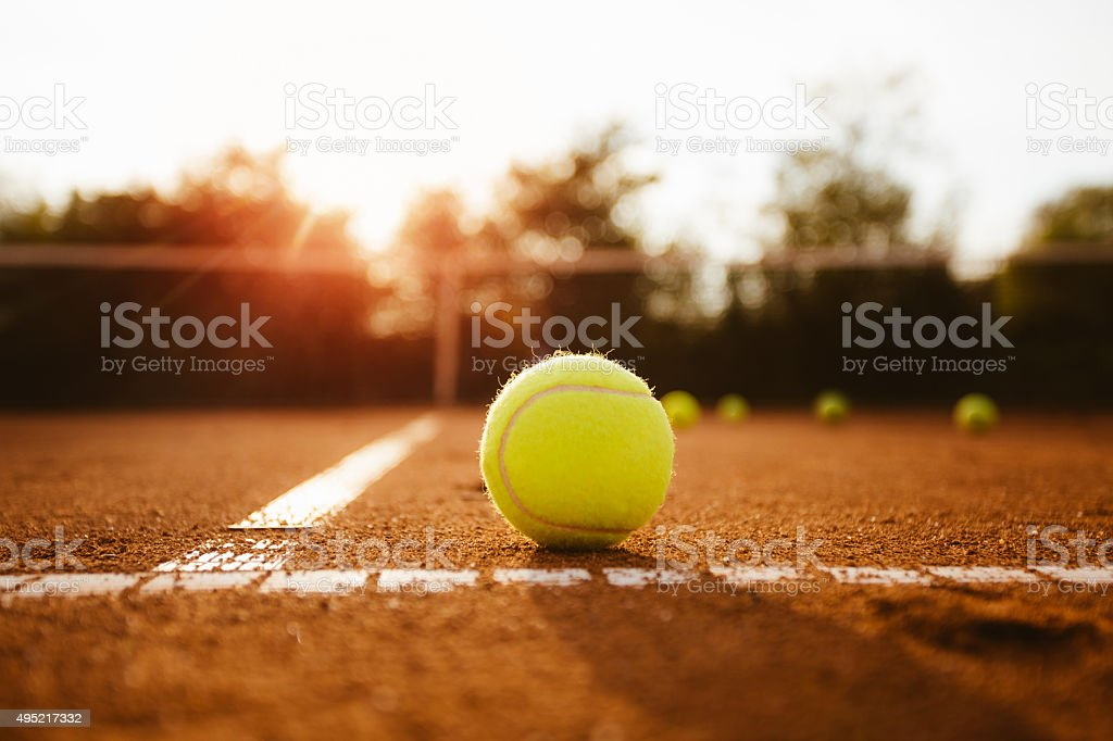 Tennis ball on a clay court stock photo