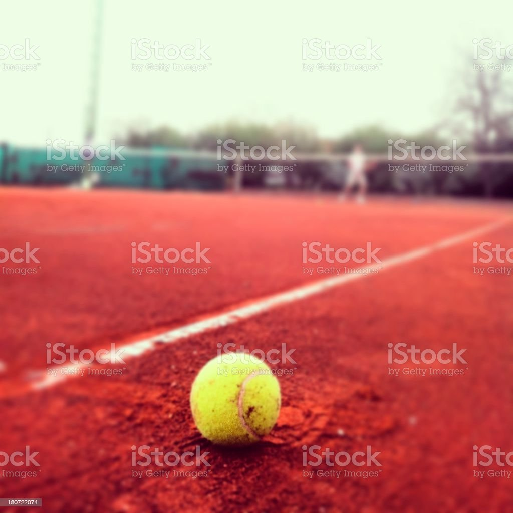 Tennis ball on a clay stock photo