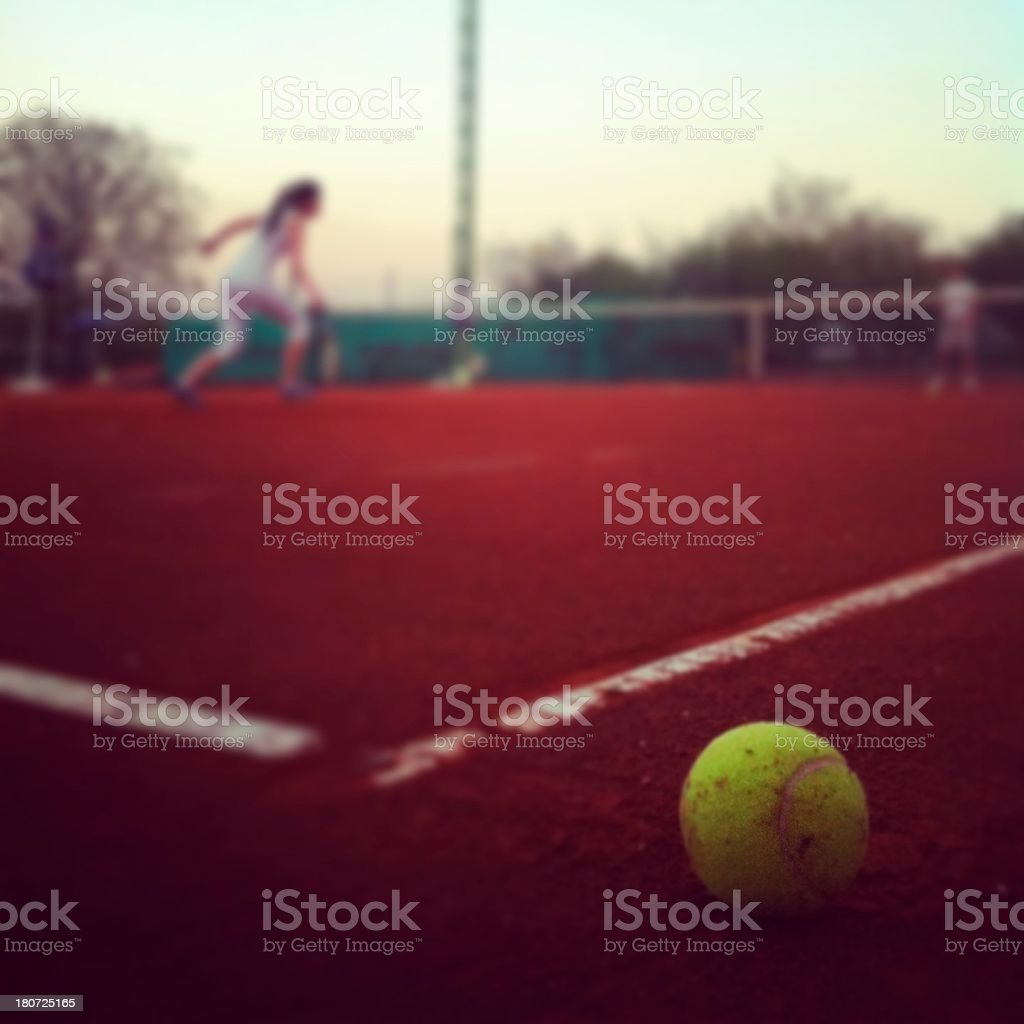Tennis ball on a clay royalty-free stock photo