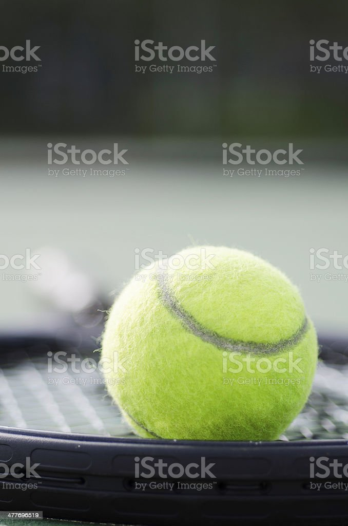 Tennis Ball on a Racquet in Early Morning royalty-free stock photo