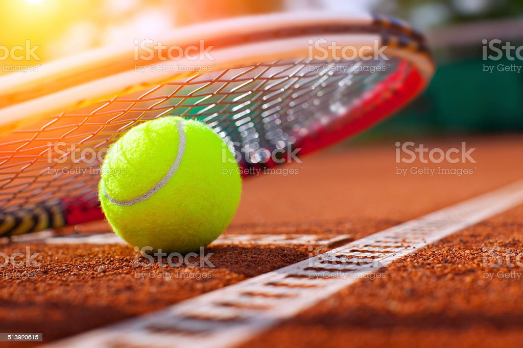 .tennis ball on a tennis court stock photo