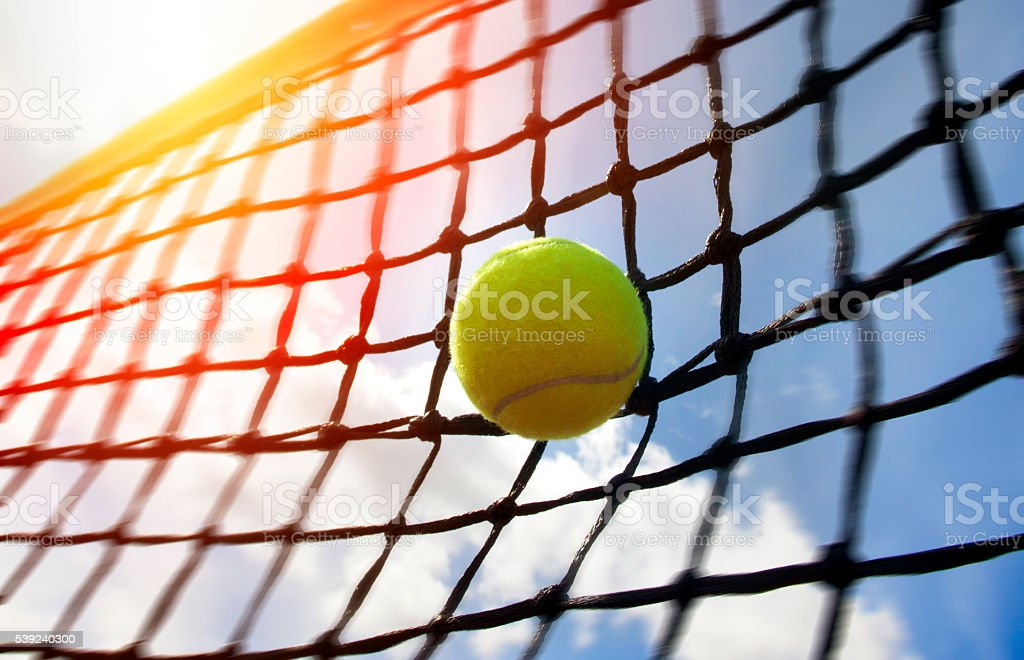 tennis ball on a tennis court royalty-free stock photo