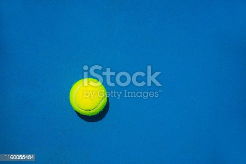 1153628111istockphoto Tennis ball on blue background. 1160055484