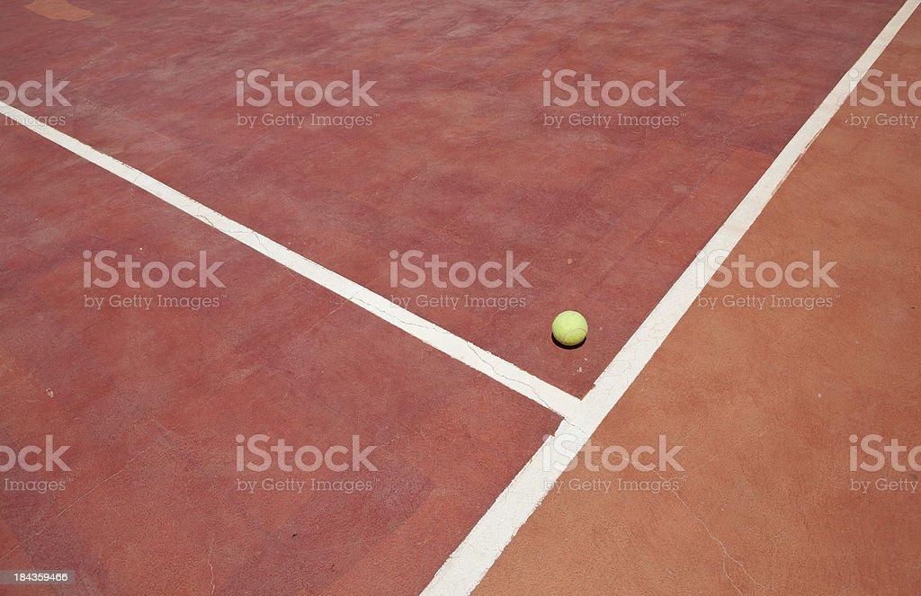 Tennis ball on court royalty-free stock photo
