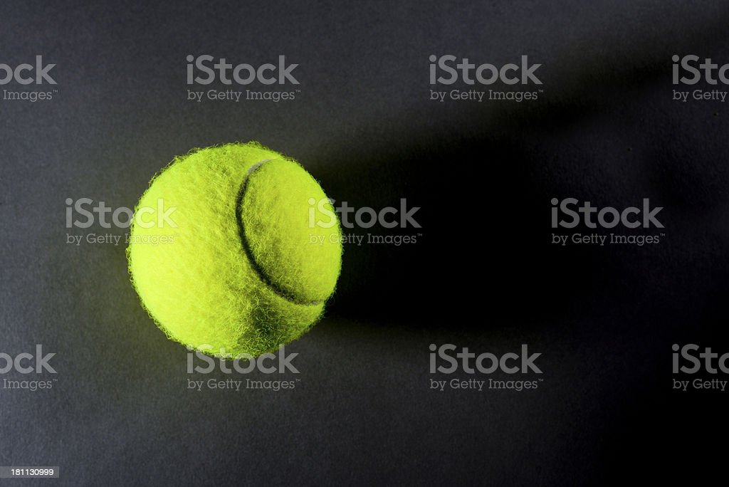 Tennis ball on dark background from above royalty-free stock photo