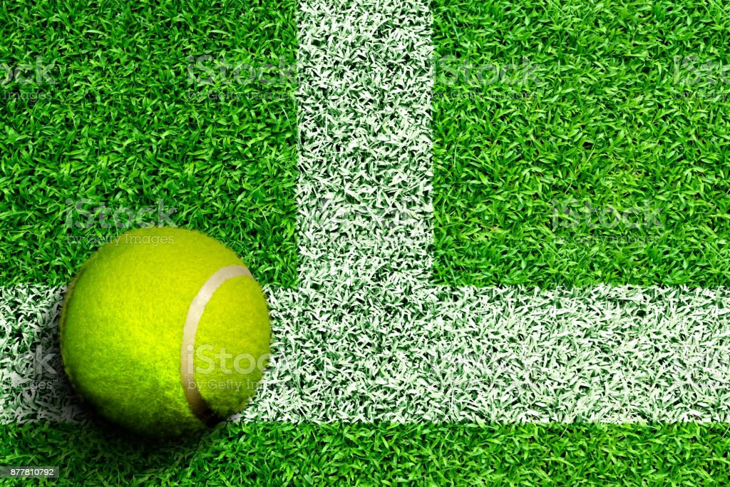 Tennis Ball on Grass Court With Copy Space stock photo