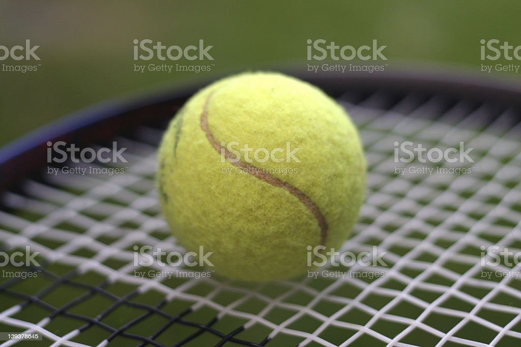 Tennis Ball on Racket royalty-free stock photo