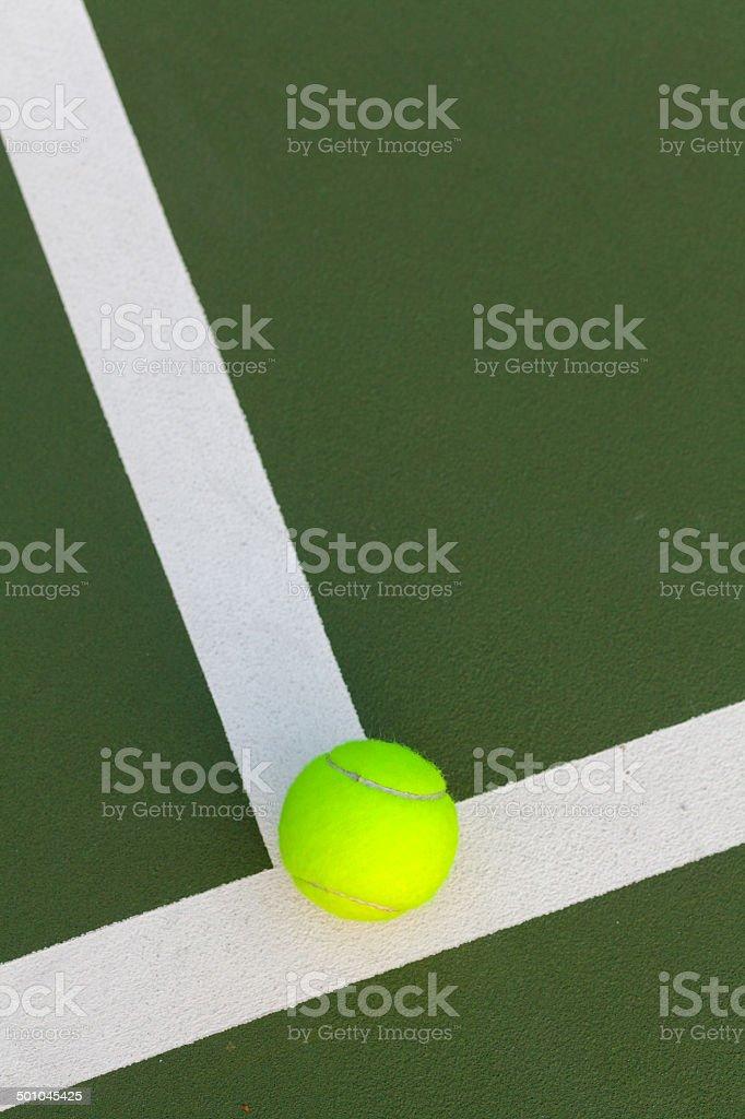 Tennis ball on the court stock photo