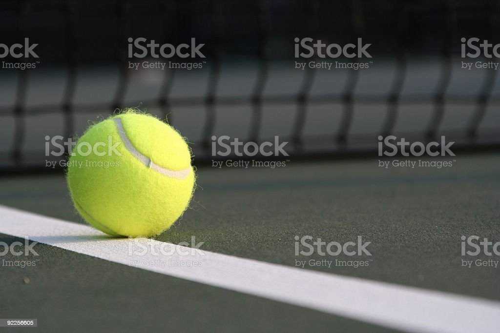 Tennis Ball on the Diagonal Court Line royalty-free stock photo