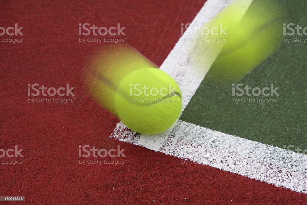 Tennis Ball on the Line stock photo