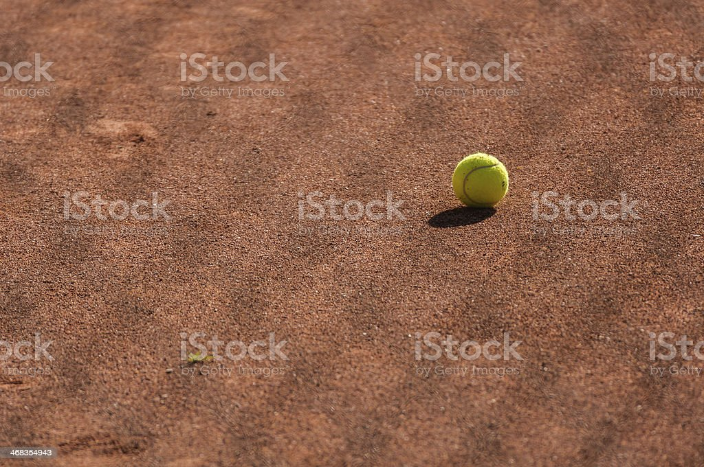 Tennis ball on the red clay royalty-free stock photo