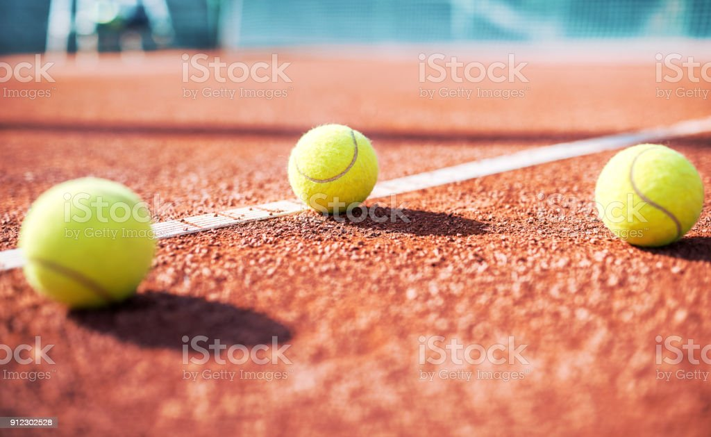Tennis ball on the tennis court. Sport, recreation concept stock photo