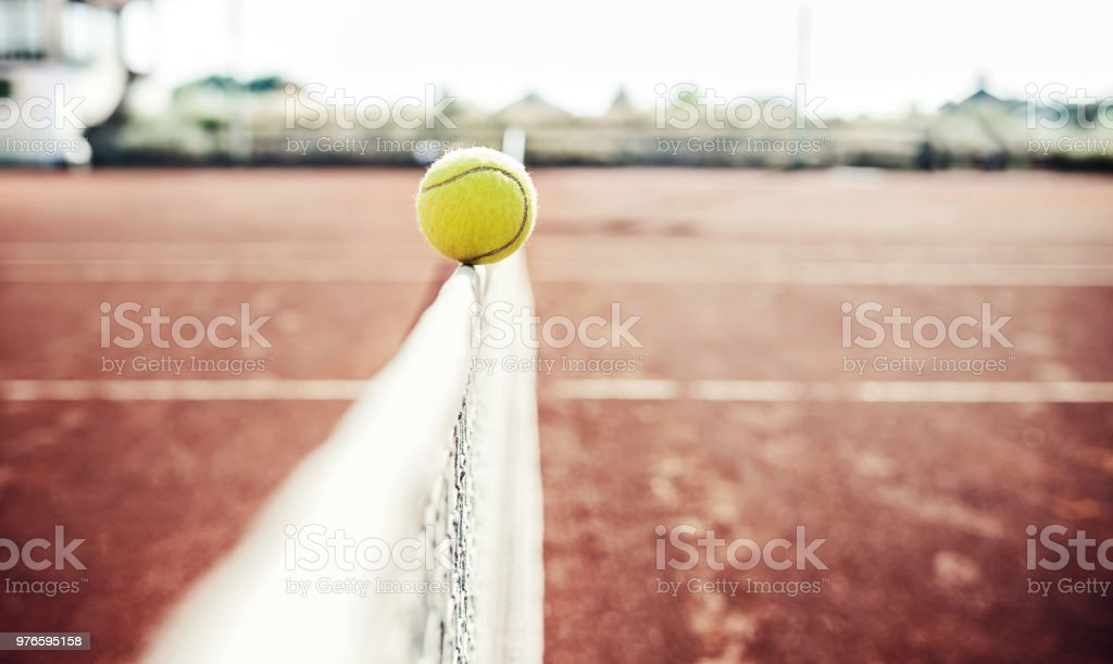 Tennis game. Tennis ball on the tennis court. Sport, recreation...