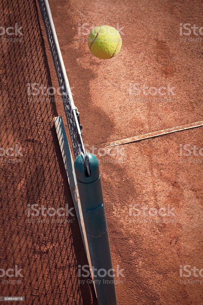tennis ball over the net stock photo