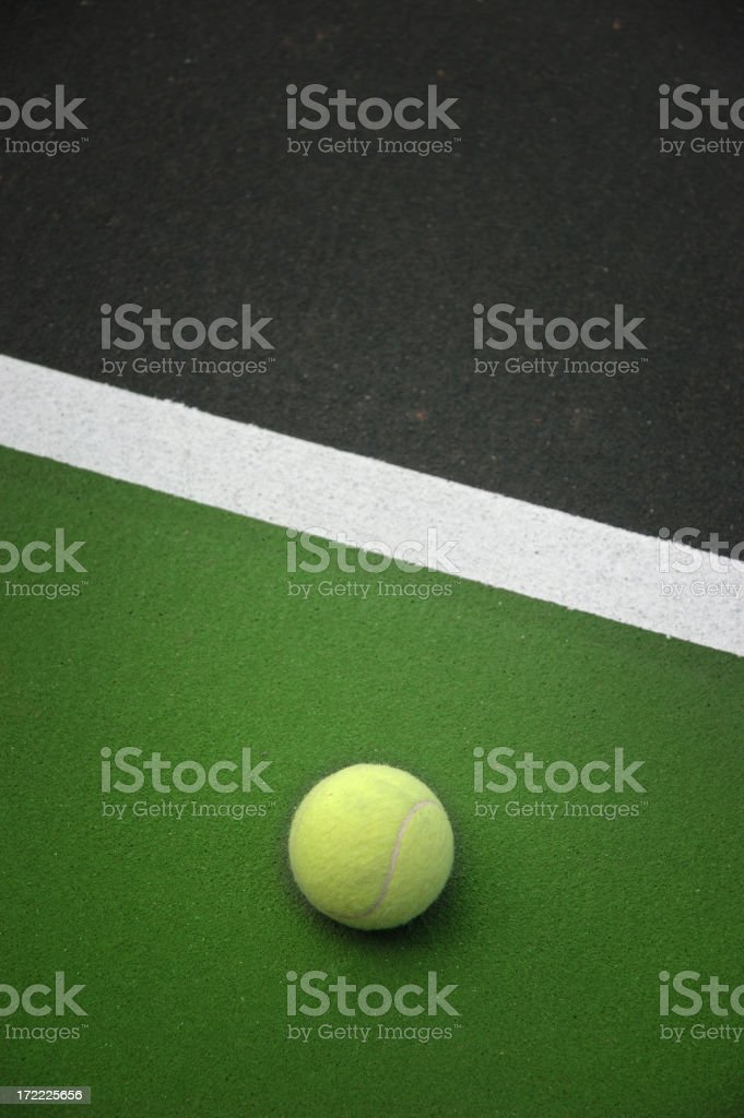 tennis ball resting in vertical stock photo