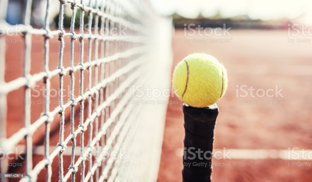 Tennis game. Tennis ball with racket on the tennis court. Sport,...