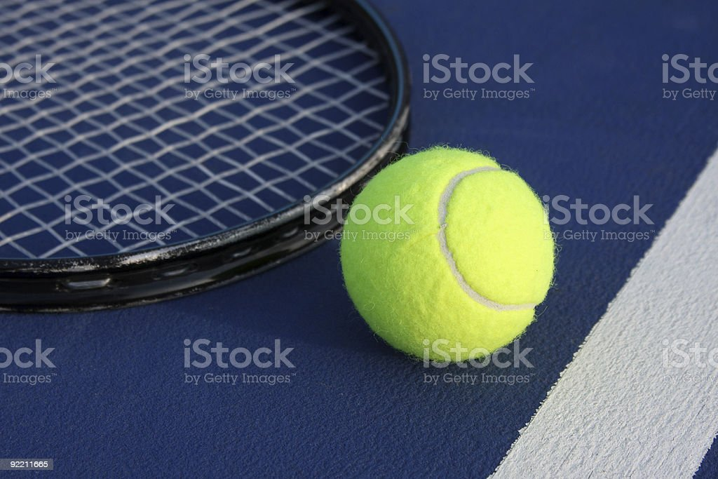 Tennis ball with Racquet on a Modern Court royalty-free stock photo
