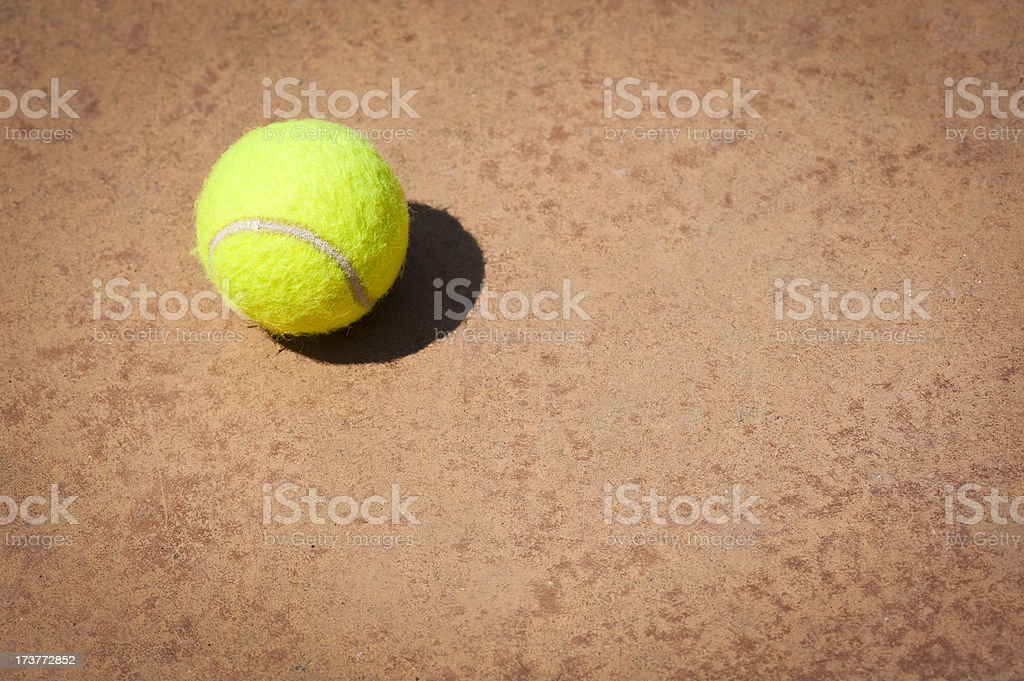 Tennis Ball with Selective Focus on Dry Earth stock photo