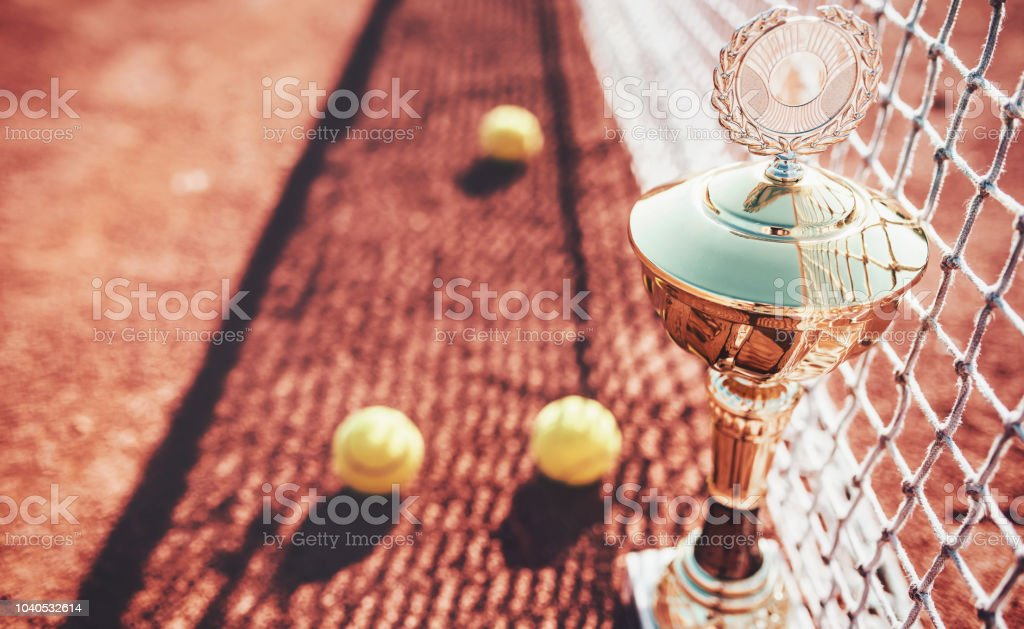 Tennis game. Tennis balls and cup on the tennis court. Sport,...