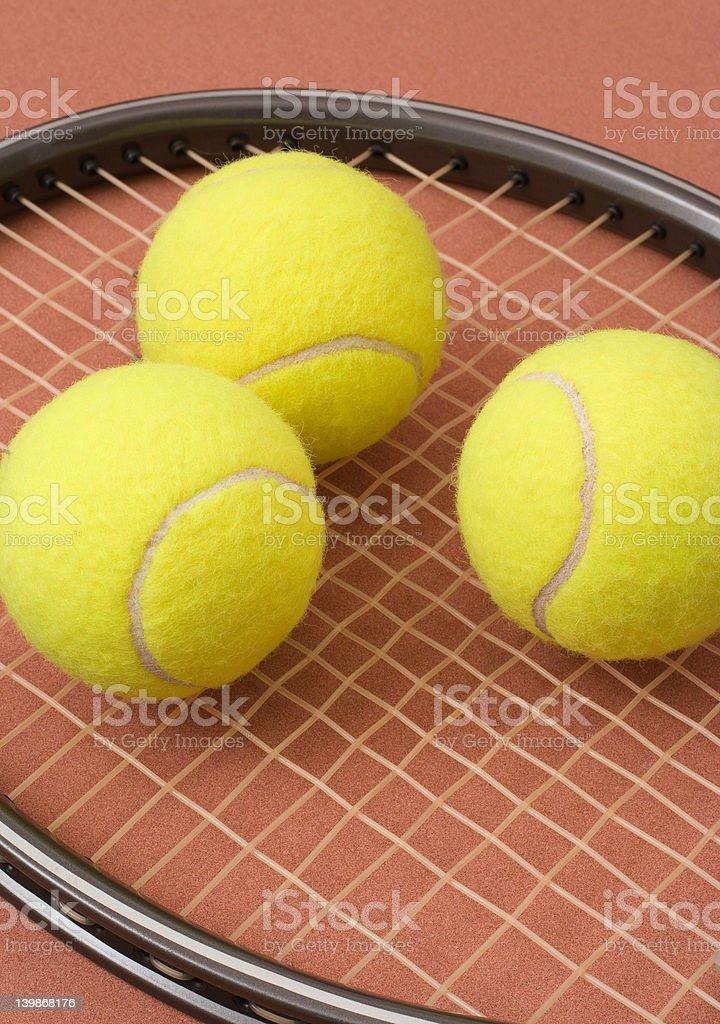 Tennis balls and racket stock photo