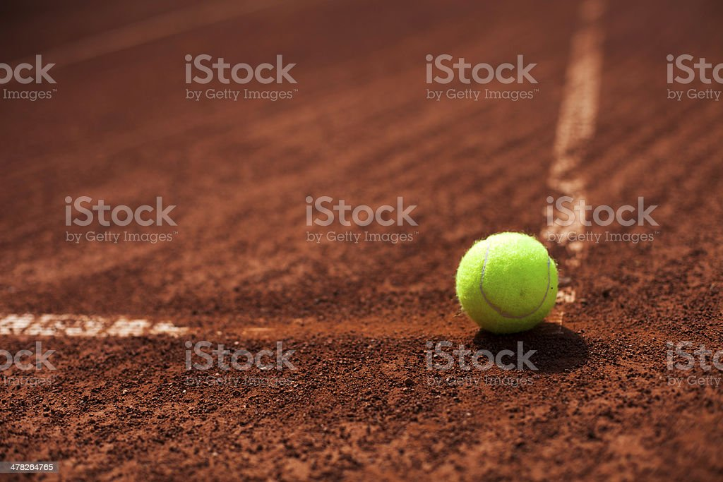 Tennis balls and rocket on court field royalty-free stock photo