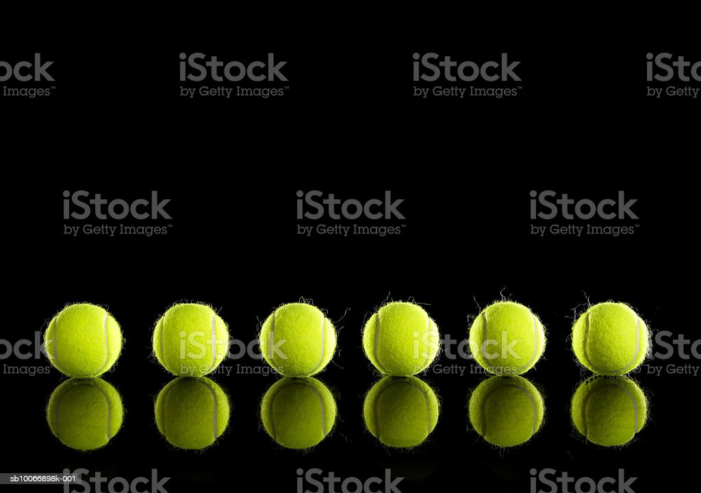 Tennis balls in row royalty-free stock photo