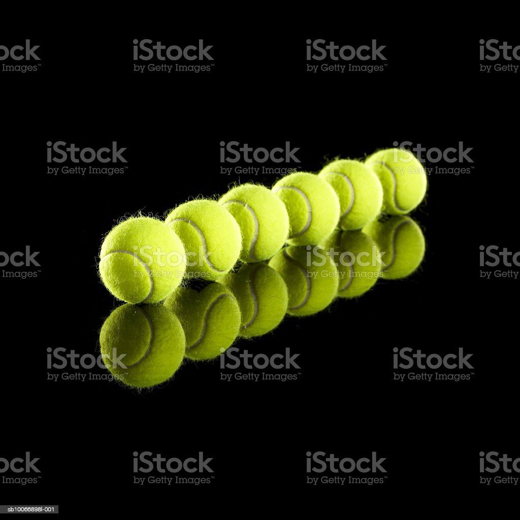 Tennis balls in row royalty free stockfoto
