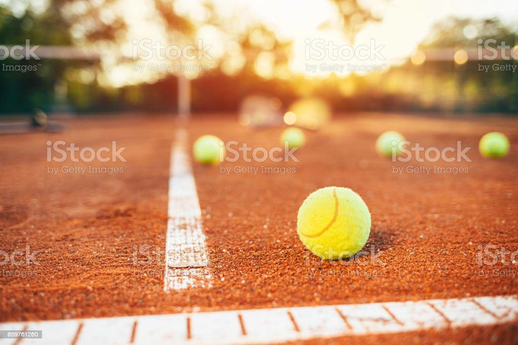 Tennis balls on tennis court stock photo