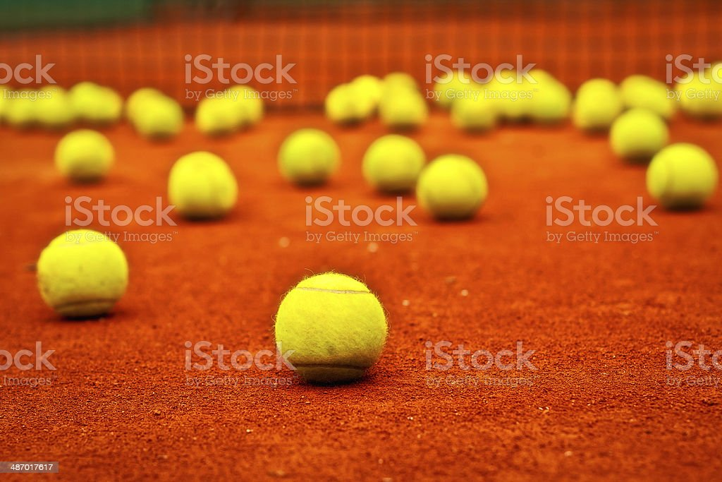 Tennis balls on the clay court stock photo