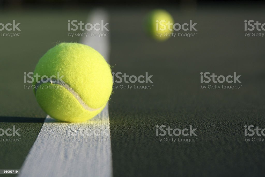 Tennis Balls on the Court royalty-free stock photo