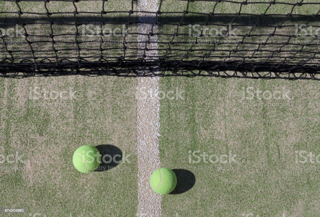 Tennis Balls with Net in the Background stock photo