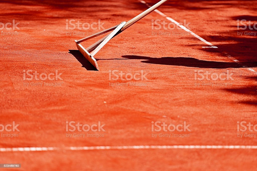 Tennis clay court maintenance stock photo