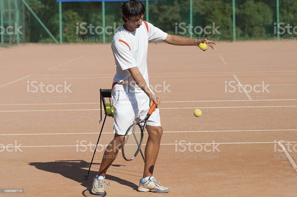 tennis coach hitting forehand royalty-free stock photo