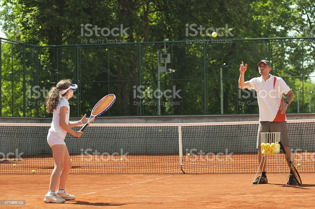 Tennis coach with student in training stock photo