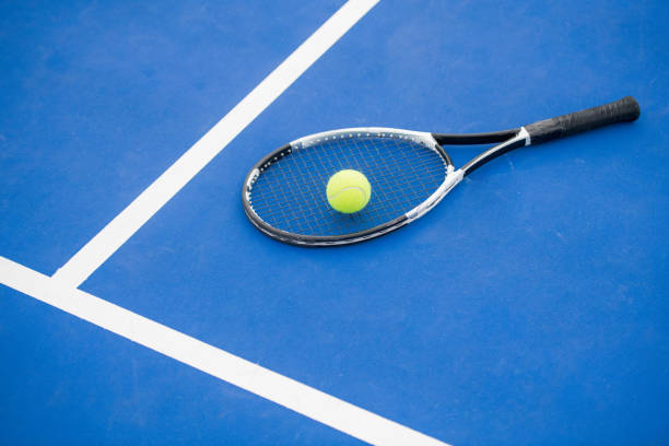 tennis concept on blue - racket stock pictures, royalty-free photos & images