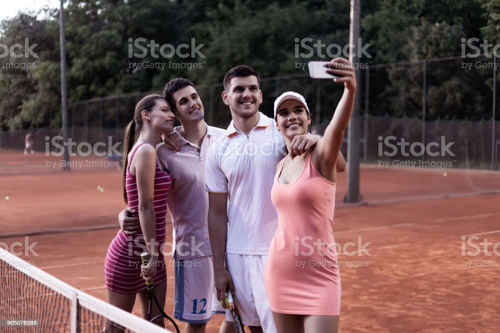 tennis couples taking selfie royalty-free stock photo